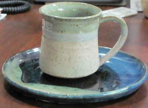 Green pottery mug and blue-green pottery plate