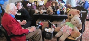 Fan Guest of Honor David Kyle, and Judy Bemis converse with the attendees of the Teddy Bear Tea