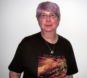 There was a call for a photo of the purple hair. Here we have Sharon modelling the purple hair and the always-stylish John Picacio art t-shirt from Chattacon 37. Photo by Steve Miller