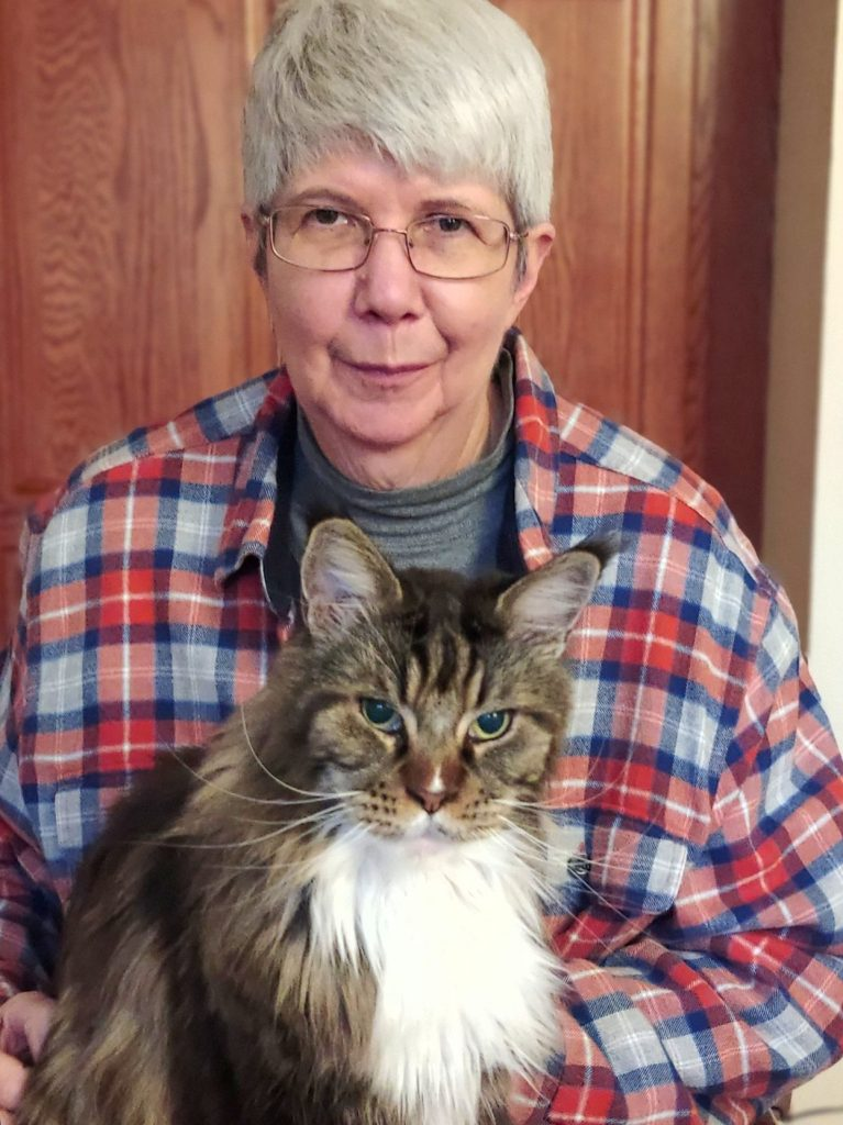 A portrait of an author with her cat